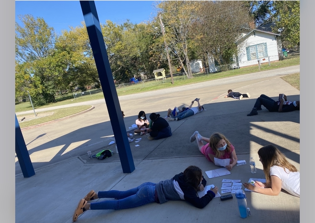 Students enjoy the fresh air while learning!